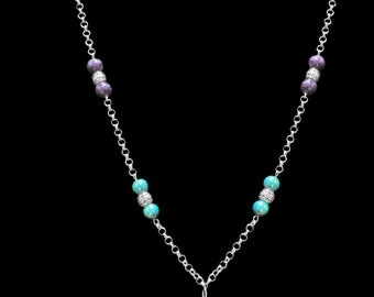 Striking lion pendant with aqua and purple beads