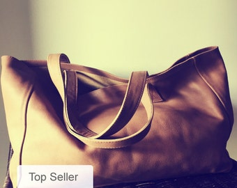 Caramel leather tote, super soft leather. Traditional,shoulder leather tote, strong straps,perfect tote bag. Large shoulder bag, lined.
