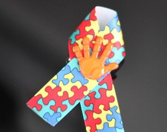 Autism Awareness Ribbons With Orange Hand