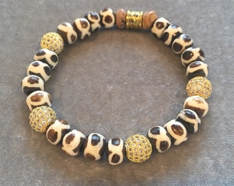 Tribal beaded stretch bracelet with gokd pave beads
