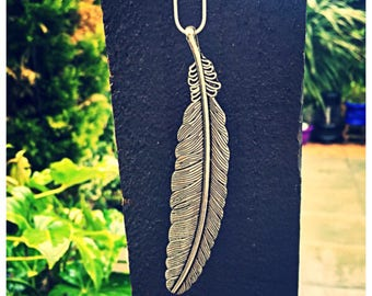 Beautiful large feather necklace with 925 silver chain. Gift bag packaged.