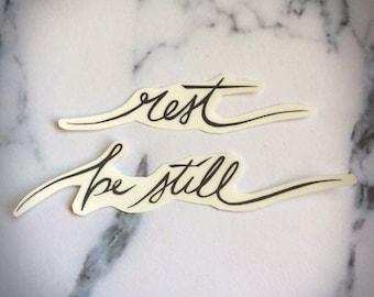Rest Be Still Temporary Tattoo Script Calligraphy Cursive Flowing Text Black Simple Minimalist Peace Calm Encouragement Scripture Church