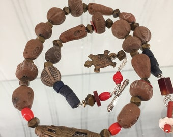 African Clay and Brass Trade Bead Necklace, Eye, Serpent and Skull Beads, Sterling Silver Chain and Toggle Clasp, 22 Inches