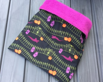 Halloween ghosts, pumpkins and graveyard cuddle sack for small pets. Available in a range of fleece colours.