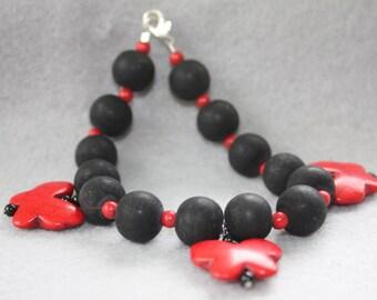 Black with Red Butterflies Bracelet