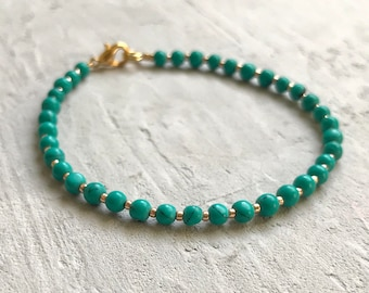 turquoise round beaded bracelet with gold