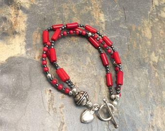 Coral, Hematite Three Strand Bracelet.
