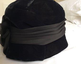 1950s small velvet cloche black hat with silk flower.