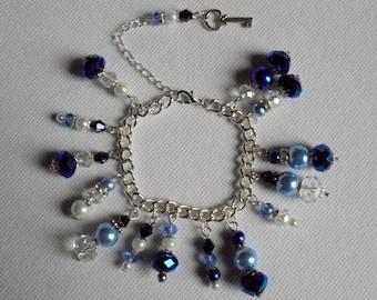 Shades of blue  glass pearl and Czech crystal charm bracelet. Friendship bracelet. Beaded bracelet. Statement jewellery.