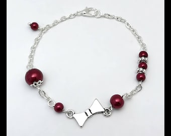 """""""Bow"""" bracelet and crimson red glass beads"""