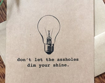 """Funny greeting card: """"don't let the a**holes dim your shine"""""""