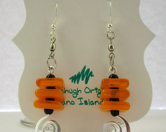 Orange glass square and black swirl earrings....love these because they are so different!