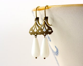 Delicate brass earrings with white drop bead