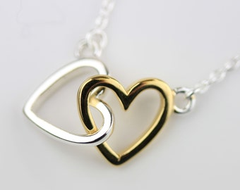 Interlocking Pair Of Solid Silver and Gold Hearts Necklace