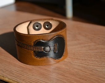Leather cuff with hand tooled Guitar