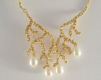 14 karat gold necklace of seaweed design with freshwater pearls