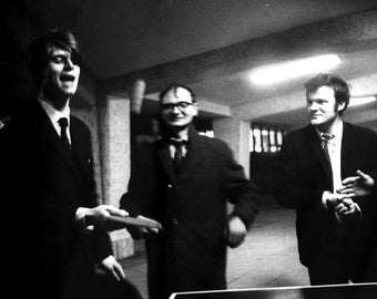 Black and White Photograph Men behaving badly, playing Ping Pong or table tennis in Lewis's underpass Birmingham 1967/68 student rag week