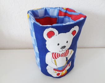 Padded basket, storage diaper, wipes, baby bear
