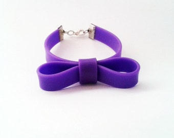 Purple bow bracelet, rubber bow bracelet, cute bow bracelet, purple plastic cuff, mauve cute bracelet, purple bow jewelry, purple arm candy