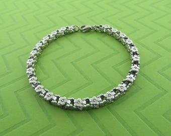 heavy sturdy stainless steel flower bracelet