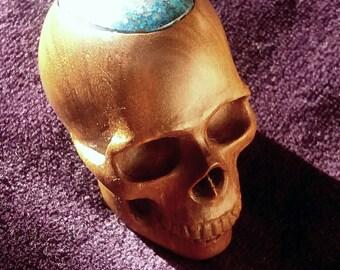 dark camphor tree wooden skull with chrysocolla  cap.