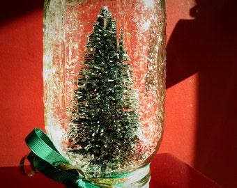 Mason jar snow globe winter scene