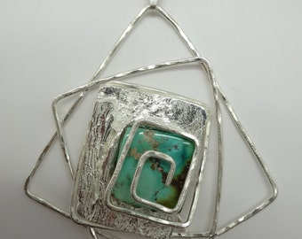Unique designed modern/classic pendant with a turquoise stone