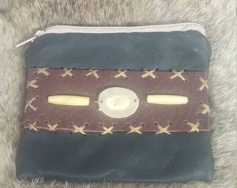 Antler and bone leather change bag