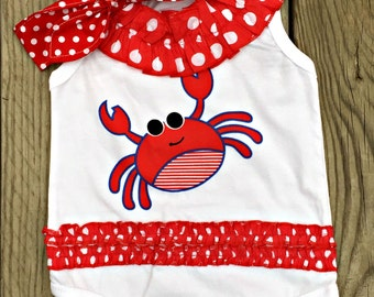 Ruffled polka dot crab onesie with matching knotted headband