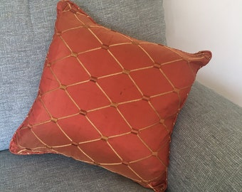 Embroidered terra-cotta cushion cover