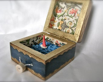 automaton sailboat in upcycled gold painted box