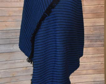 Blue and black handwoven poncho.  Has long pointed front with shorter straight back.