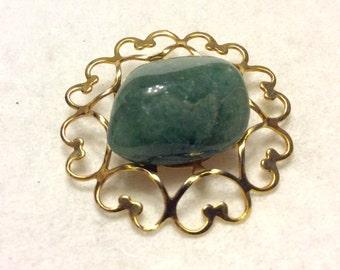 Green aventurine stone on gold hearts frame brooch pin.