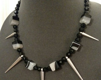 Choker necklace with black / white agate cubes, black beads and metal spikes