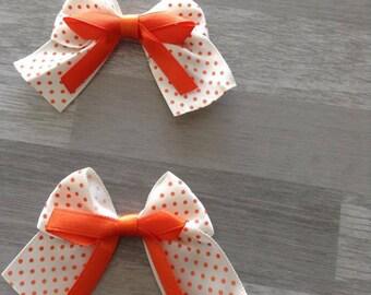 5 flower applique beige satin bow has orange dots
