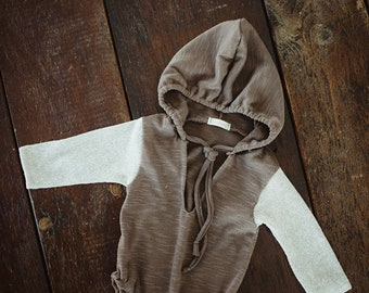 Brown and cream hoodie.  Sitter