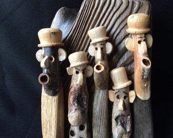 Driftwood figures, driftwood art, driftwood men.