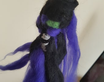 White witch in purple and black inc white sage broomstick
