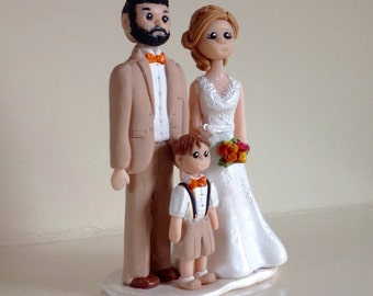 Wedding Cake Topper.-  Polymer clay keepsake of bride and groom with one small child