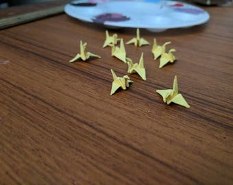 10 tiny yellow paper cranes