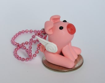 Pierce the polymer clay winged pig charm
