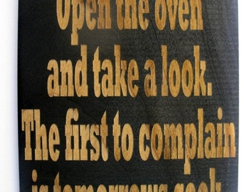 Open the oven and  take a look the first to complain is tomorrows cook wooden kitchen sign