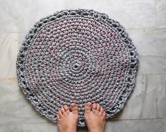 Grey round crochet rug