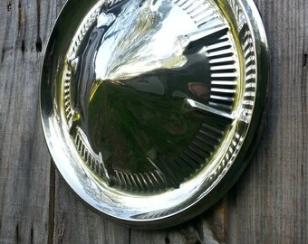 1960's Ford hubcap, in good condition, shines nicely,men's gift, great garage, man cave or office piece. Memorabilia, collectible,