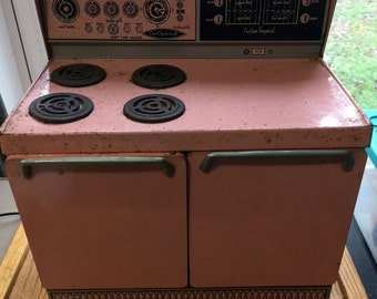 """Vintage Wolverine Tin Lithograph 12 1/4 """" Tall Pink Oven Stove Tin Toy 1950 Era"""