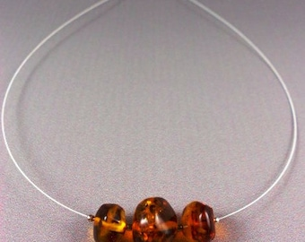 Baltic Cognac Amber Nuggets on Illusion wire