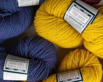 Peace Fleece yarn, worsted weight wool yarn, violet purple, bright yellow, raspberry pink