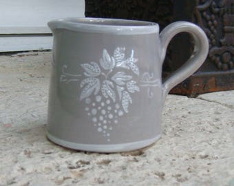 Creamer-jar has milk, grey enamel decor cluster in white