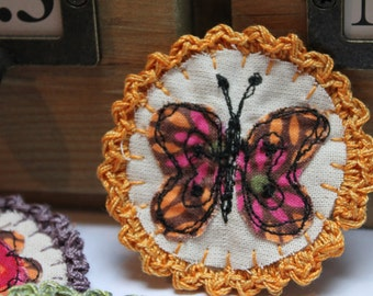 Crochet Edge Textile Fabric Brooch. Embroidered butterfly brooch with hand crocheted edge