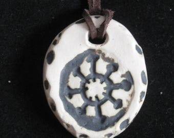 Handmade pendant with the Symbol of Chaos. Chaos Star